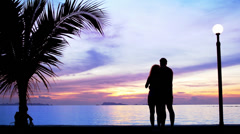 Silhouette couple in love make photo against beautiful sunset - stock footage