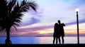 Silhouette couple Make Photo against Sunset Footage