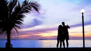Silhouette couple Make Photo against Sunset Stock Footage