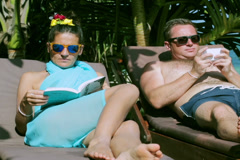 Couple chilling in the swimming pool, steadycam shot Stock Footage