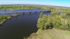 Beautiful   flight over  river with bridge  and   wood Aerial  spring time Stock Footage