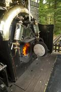 Footplate and open firebox on narrow gauge steam locomotive Stock Photos