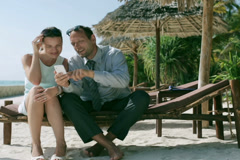 Businesspeople using mobile phone in exotic place, steadycam shot Stock Footage