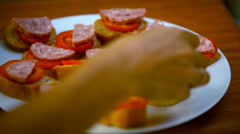 Chef makes sandwiches with pate, tomatoes, sausage and fennel. Macro Stock Footage