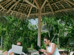 Businesspeople working on modern technology in exotic place, steadycam shot Stock Footage