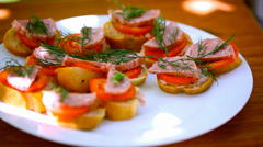 Sandwiches with pate, tomatoes, sausage take off from plate, eat them and leave Stock Footage