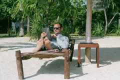 Businessman working on tablet in exotic place Stock Footage