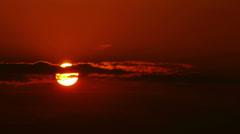 Beautiful sunrise. Sun disk shining through the cloudscape. Stock Footage