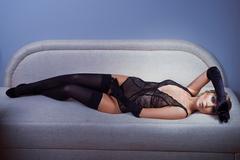 Woman in black stockings Stock Photos