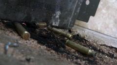 terrorist attack, fire fight, shell casings - stock footage