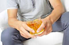 Young man hanging out with a glass of liquor Stock Photos