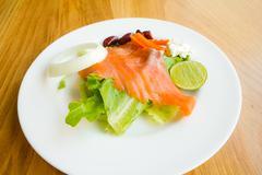 Smoked salmon with vegetables, salad Stock Photos