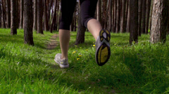 Young sports woman running on a rural road in the park. Sports lifestyle Stock Footage