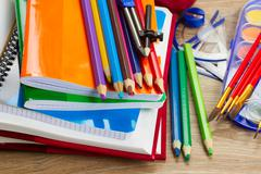 Books with school supply Stock Photos