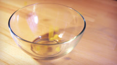 Pasta falling into the glass bowl Stock Footage