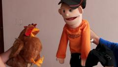 Chicken and boy puppets talking Stock Footage