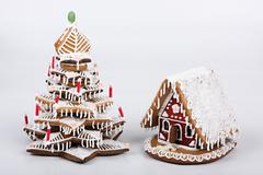 Gingerbread house with gingerbread tree - stock photo