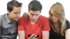 Small group of teenagers looking at a smart phone Stock Footage