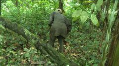 Man Clearing Brush in Forest with Machete in Rural Ghana - stock footage