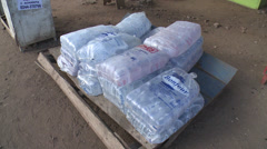 Pallet of Sachet Water in Africa Stock Footage