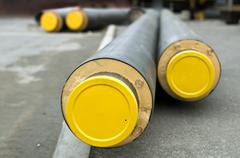 Pipes for hot water and steam heating - stock photo