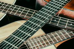 Vintage Acoustic Guitar Necks Crossed - stock photo