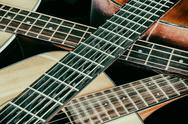 Stock Photo of Vintage Acoustic Guitar Necks Crossed