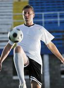 Football player in action Kuvituskuvat