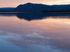 Little salmon lake sunset yukon territory canada Stock Photos