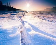 Sunny frozen tagish lake ice crack yukon canada Stock Photos