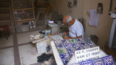 Craftsman's design shop souk Marrakech Medina Morocco Stock Footage