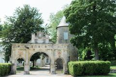 Archway in some gardens - stock photo