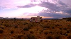 RV Camper In Arizona Desert Camping Under Setting Sun Stock Footage