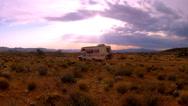 Stock Video Footage of RV Camper In Arizona Desert Camping Under Setting Sun
