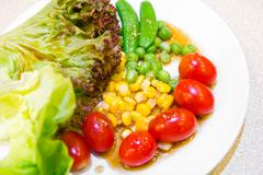 fresh vegetables salad in dish - stock photo