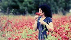 Spring woman smells poppy flowers, vintage emotion background Stock Footage