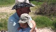 Stock Video Footage of Grandpa rocking grandson
