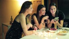 Stock Video Footage of Elegant girlfriends looking at smartphone during party HD