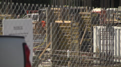 Busy construction site telephoto shot Stock Footage