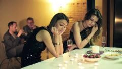 Unhappy, bored, sad girlfriends during party at home HD Stock Footage