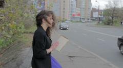 Sad girl reading book on street, feeling nostalgic, melancholia Stock Footage