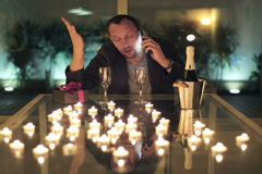 Angry man talking on cellphone with his late wife in romantic place NTSC Stock Footage