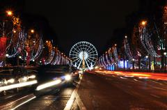 The Champs-Elysees avenue illuminated for Christmas Stock Photos