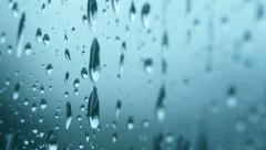 Rain Raining Against the Window on a Rainy Day - 29,97FPS NTSC 4K UHD Stock Footage