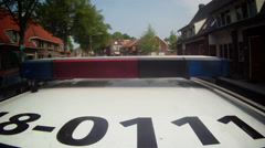 GoPro on roof of Dutch Policecar with flashing stop-sign Stock Footage