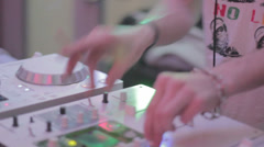 Sound engineer tweaks controls on desk, nightlife, party in club Stock Footage