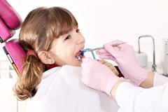 little girl patient dental exam - stock photo