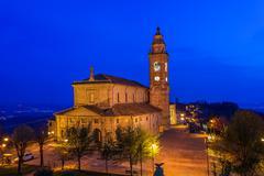 Catholic church illuminated at night. Stock Photos