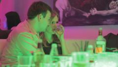 Couple flirting in nightclub, girl drinking, unhealthy lifestyle - stock footage