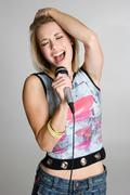 karaoke girl singing - stock photo
